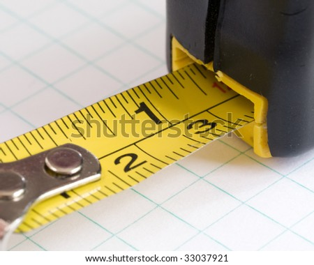 Measuring tape close up on grid paper