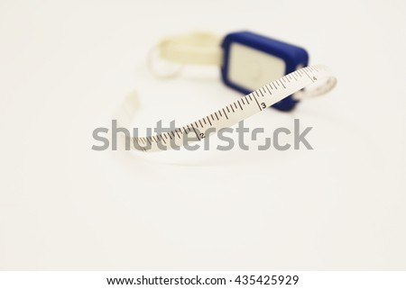 Measuring tape for control your waist - stock photo