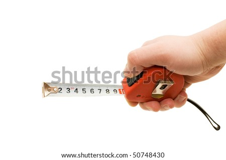 Measuring tape in a man hand - stock photo