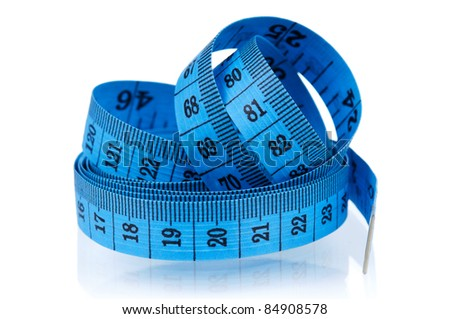 Measuring tape of the tailor over white background - stock photo