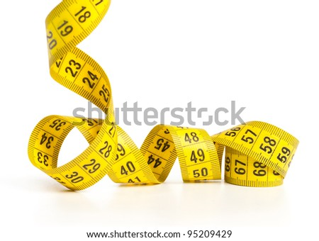 Measuring tape of the tailor over white background