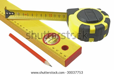 Measuring tape of yellow color, building level and pencil - stock photo