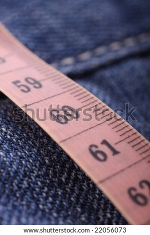 Measuring tape on jeans