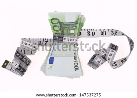 Measuring tape over hundred euro bils isolated on white background - stock photo