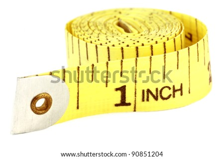 Measuring tape over white background