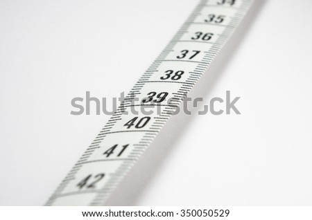 Measuring tape. Size and weight. - stock photo