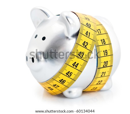 Measuring tape wrapped around piggy bank or money box, isolated on white background - stock photo