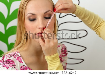 measuring the correct proportion of eyebrows - stock photo