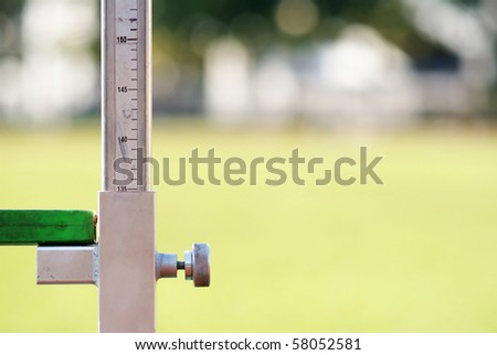 measuring the high jump athletics with nice background - stock photo