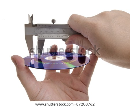 Measuring the size of information within the digital media using a caliper. Concept of information storage and compression. - stock photo