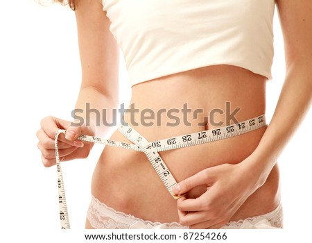 Measuring waist, isolated on white, closeup - stock photo