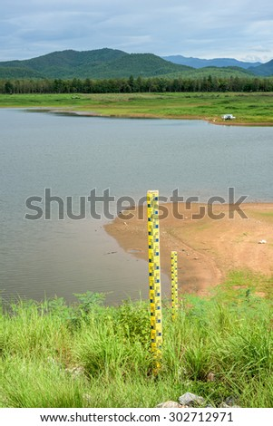 measuring water levels sign pillar on the dam - stock photo