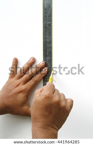 Measuring with a ruler - stock photo