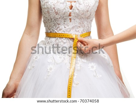Measuring woman's waist with centimeter, isolated on white - stock photo