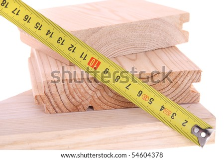 Measuring wood with yellow tape, isolated - stock photo