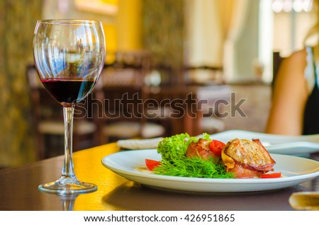 meat and a glass of wine