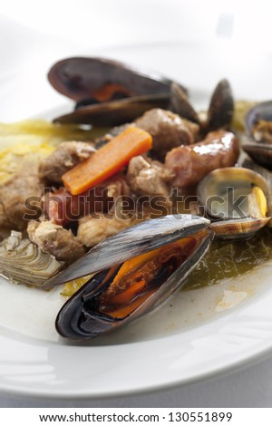 Meat and fish stew - stock photo