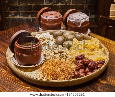 meat and herb soup in pot, Chinese food style - stock photo