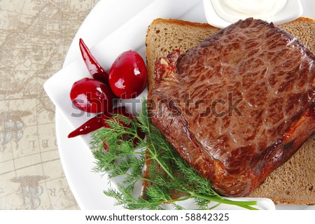meat and pepper on bread with spices - stock photo