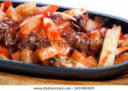 Meat and potatoes roast in tomato sauce