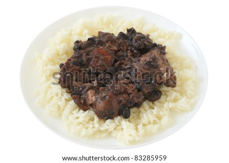 meat and sausages with beans and boiled rice