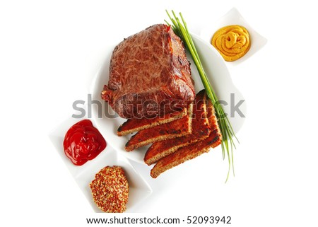 meat and spices on white bowl with ketchup and mustard - stock photo