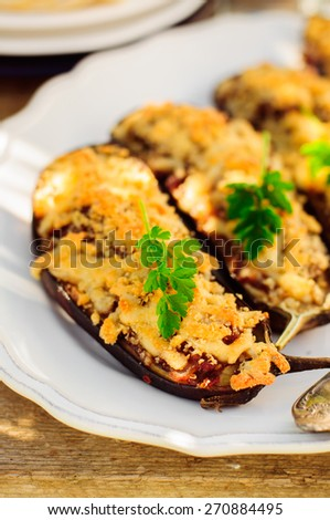 Meat and Tomato Stuffed Eggplant Halves with Cheese Crust, copy space for your text