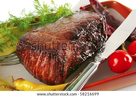 meat and tomatoes with peppers over white - stock photo