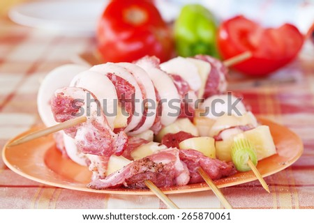 Meat and vegetables on barbecue sticks - ready to grill, shallow depth - stock photo