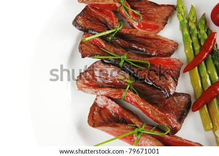 meat and vegetables on white plate with spices - stock photo