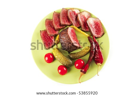 meat and vegetables with peppers on green
