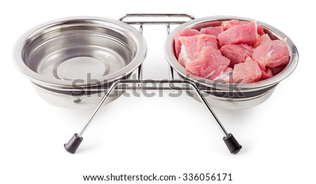 Meat and water for pets in metal bowls isolated on white background. Healthy food for dogs and cats. - stock photo