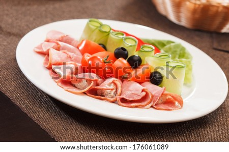 Meat appetizer with vegetables - stock photo
