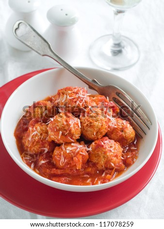 Meat balls in tomato sauce with cheese, selective focus