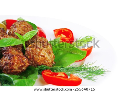 meat balls on basil leaf with olives and tomatoes - stock photo