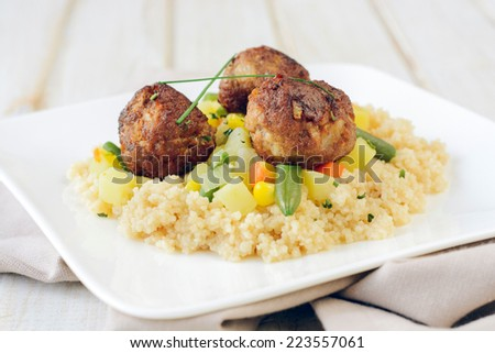 Meat balls with couscous and vegetables,selective focus  - stock photo