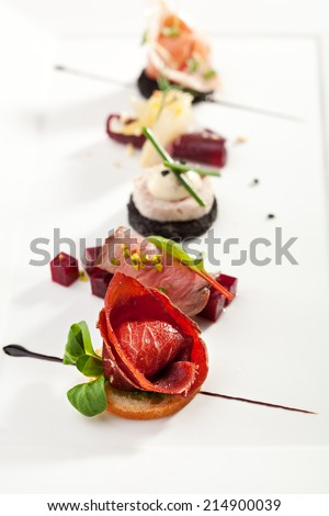 Meat Canapes on White Dish - stock photo