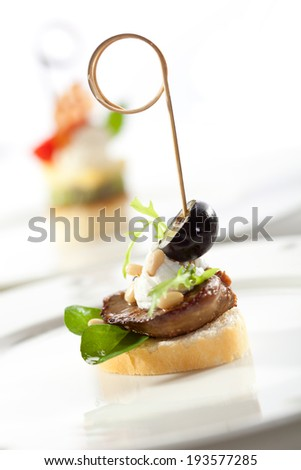 Meat Canapes with Pine Nuts and Sauce - stock photo