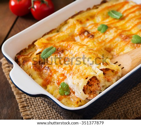 Meat cannelloni sauce bechamel  - stock photo