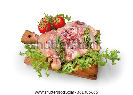 Meat chicken composition on cutting board with lettuce and tomatoes