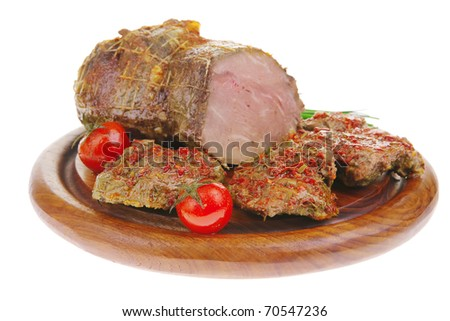 meat chops with green chives on wooden plate isolated over white background  . shallow dof - stock photo