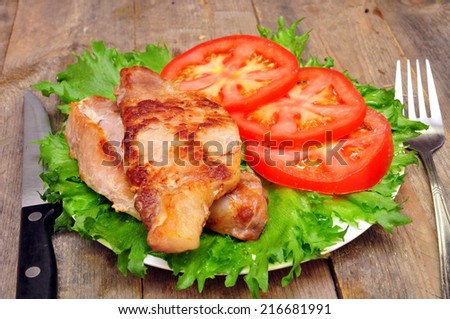 meat chops with tomatoes in a bow - stock photo