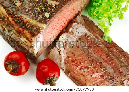 meat chunk with slices and pepper on white - stock photo