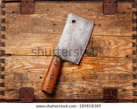 Meat cleaver on wooden background  - stock photo