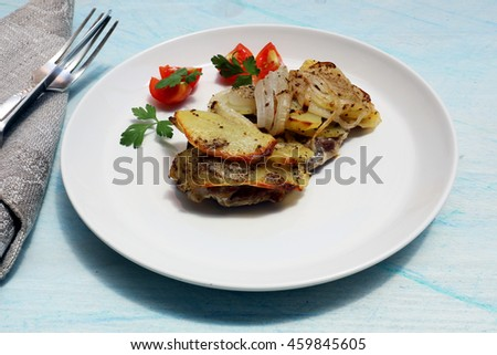 meat cooked with potatoes onions and spices