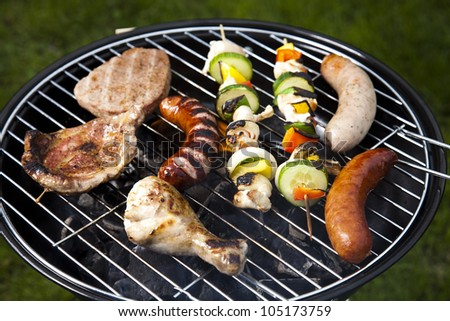 Meat cooking on barbeque
