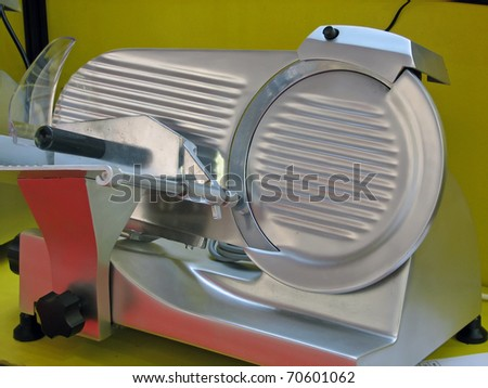 Meat cutting machine. Stainless steel meat machine. - stock photo