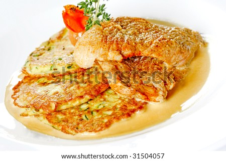 meat dish with potato pancakes