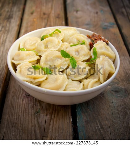 Meat Dumplings - russian boiled pelmeni in plate  - stock photo
