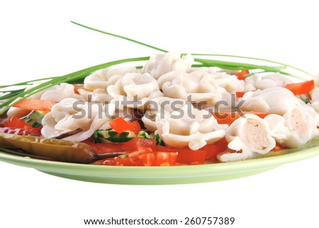meat dumplings served on green plate with vegetables - stock photo